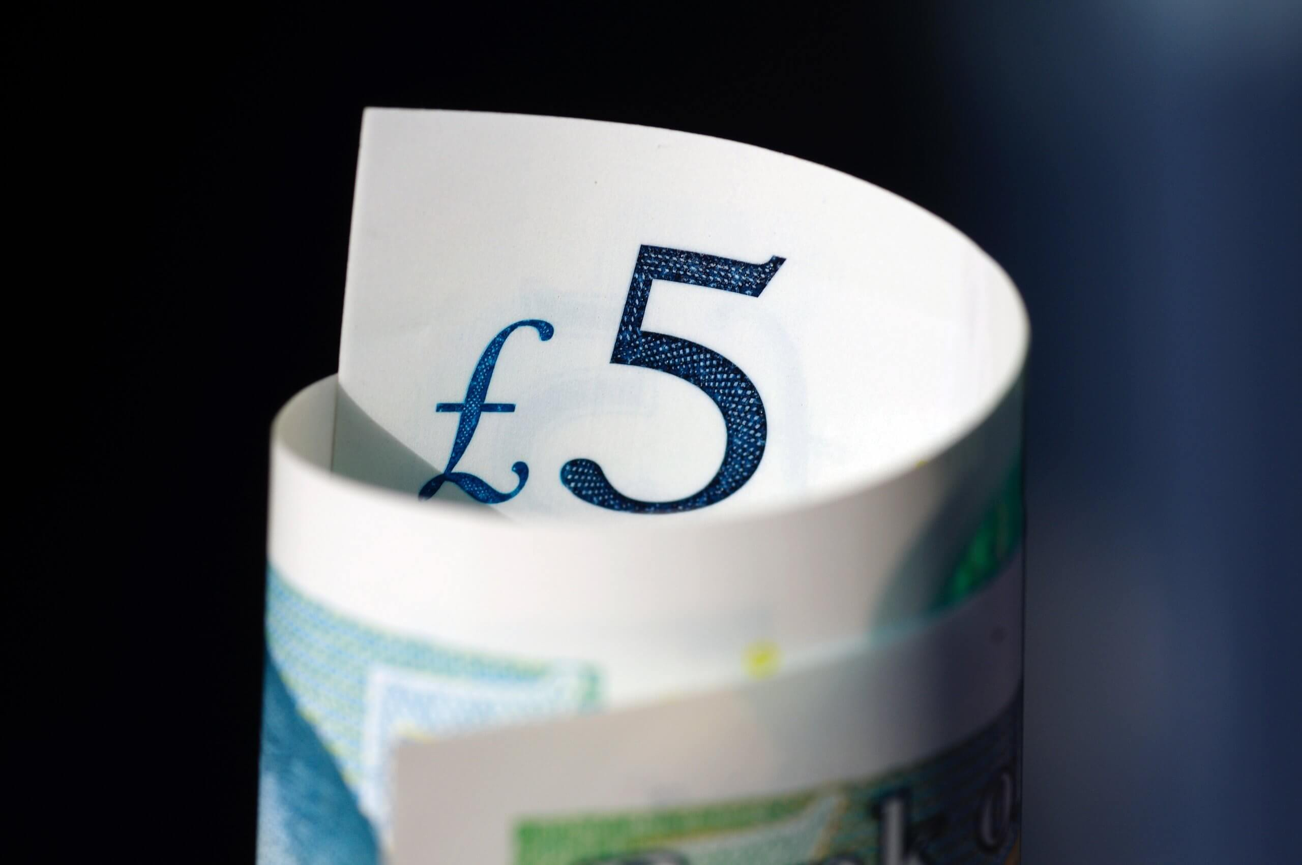 Rolled up five pound note