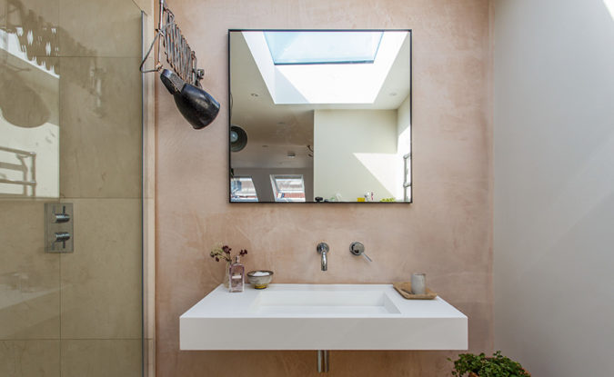 Mirror on the wall of a bathroom in a loft conversion.