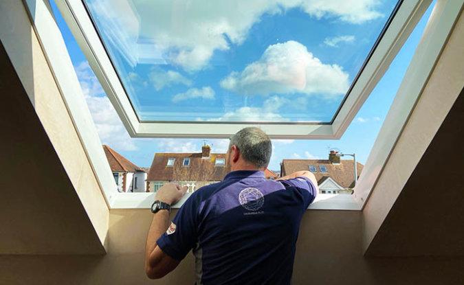 A man repairing a VELUX window.