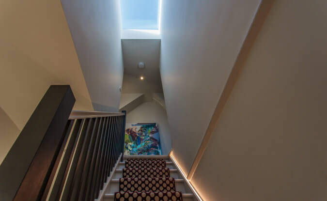 Staircase leading up to loft with skylight