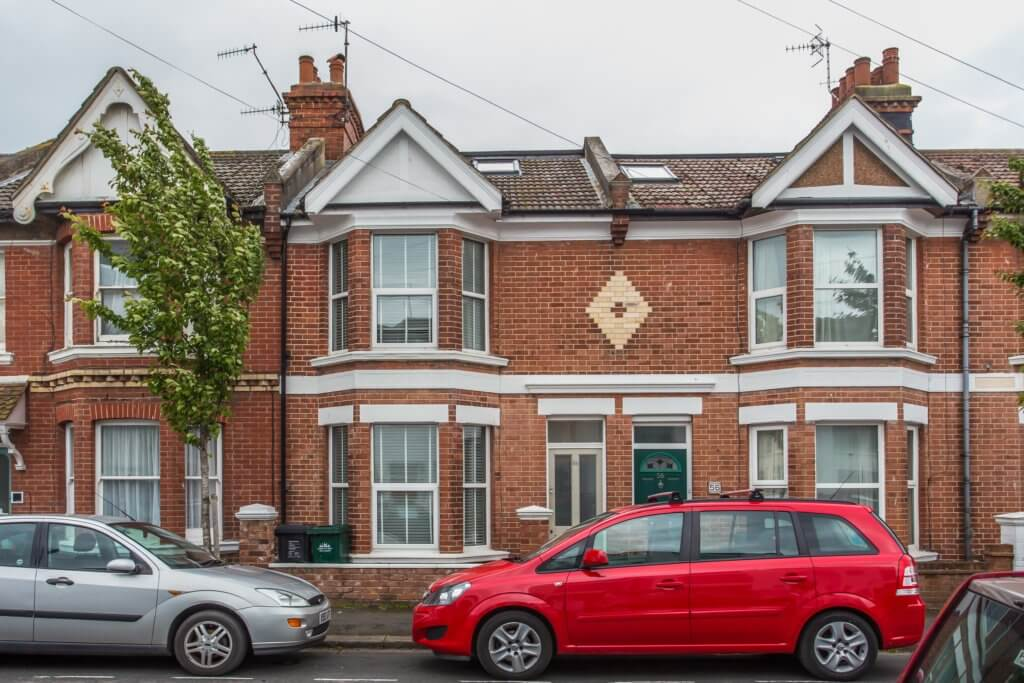 A terraced house with a loft conversion and VELUX window built by TrustMark builders