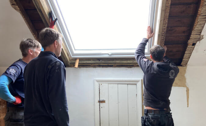 velux installed from inside by three builders